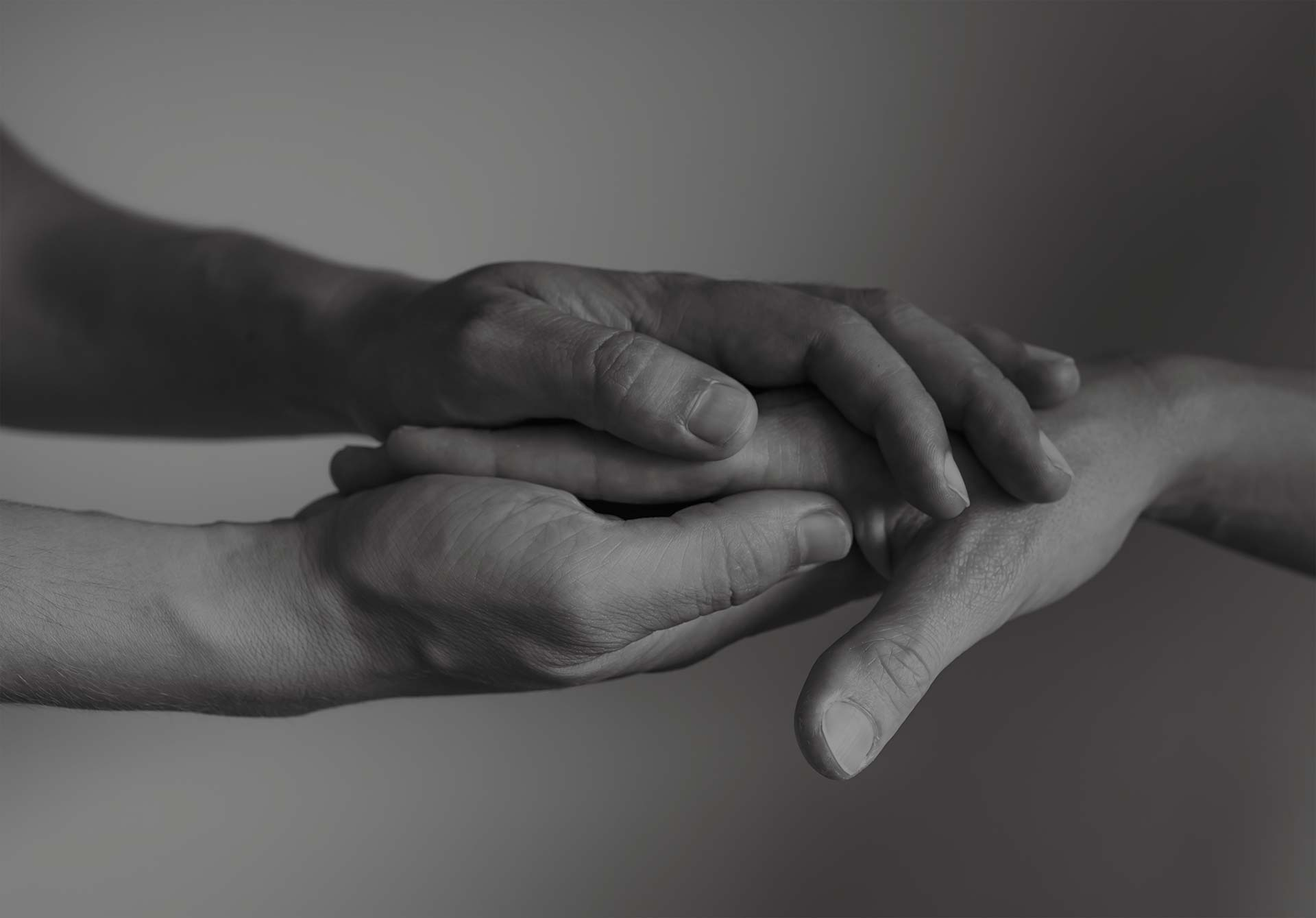 Hand holding another hand